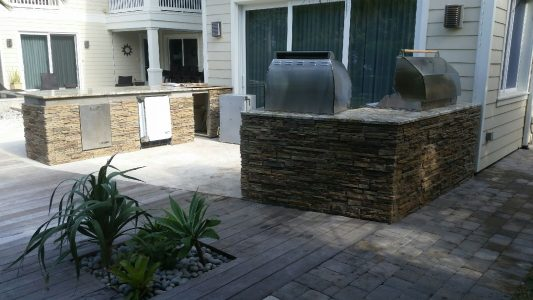 Custom Outdoor Kitchen in Casey Key with Two Custom BBQ Islands