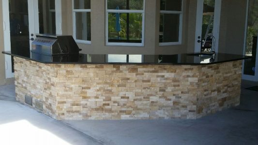 Custom Outdoor BBQ in North Port with Granite Counter Tops and Stonework