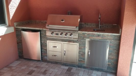 Outdoor Kitchen with Granite and Summerset grill