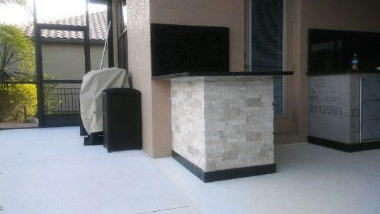 A unique split design with granite countertops and stone facade