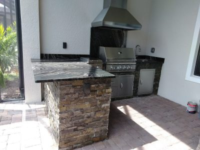 Outdoor Kitchen in Lakewood Ranch with Marbled Granite Counters