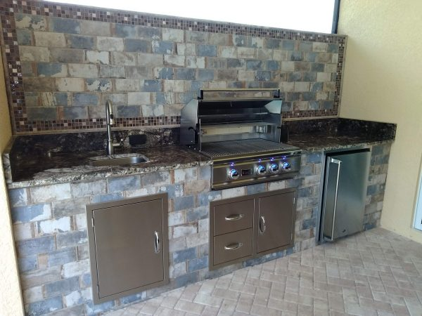 Tiled Backsplash and Face with Level 5 Granite Countertops
