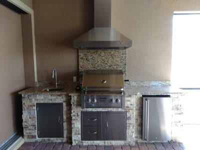 Lakewood Ranch outdoor kitchen with Summerset grill, fridge, sink, hood vent