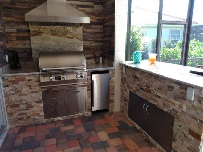 Custom outdoor kitchen with Travertine face