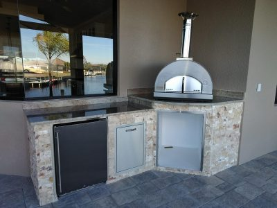 Outdoor Kitchen in Punta Gorda with a Fontana Forna Pizza Oven and Summerset fridge