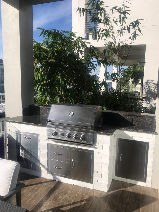 outdoor kitchen on the second floor of a fort myers beach home