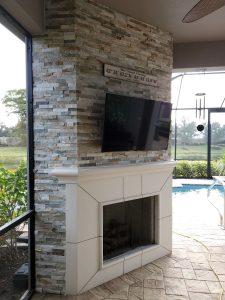 custom outdoor fireplace on a Florida lanai