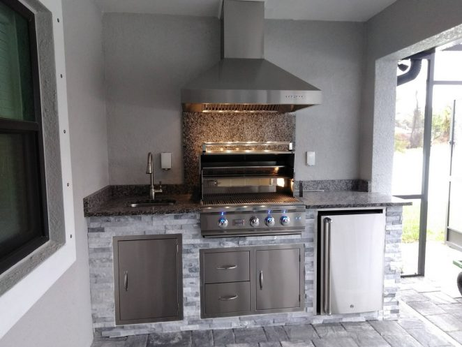 compact outdoor kitchen with gray stone and gray granite