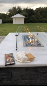 fire table with s'more makings