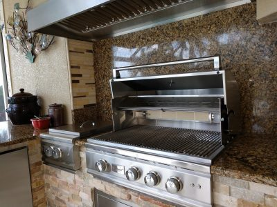 Summerset grill and power burner installed in an outdoor kitchen