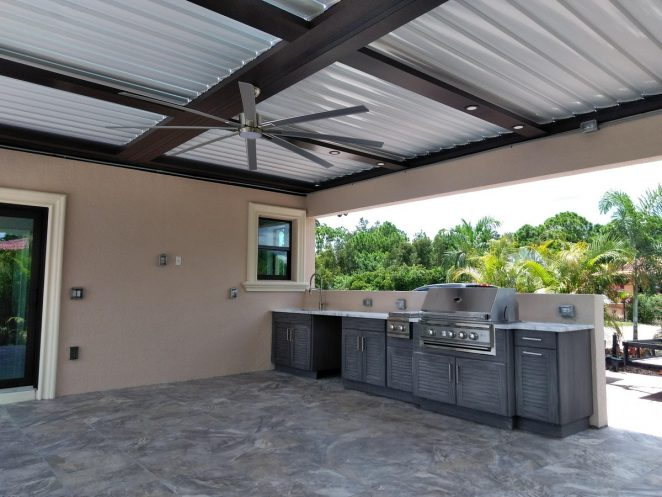 pergola, fan and outdoor kitchen