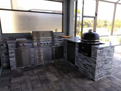 outdoor kitchen with a grill and smoker